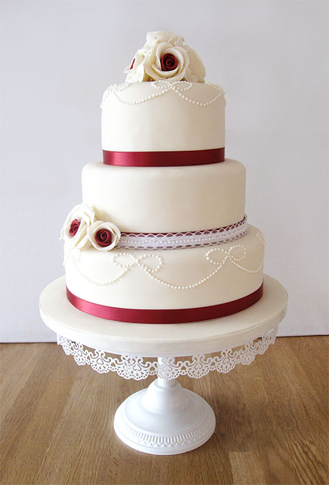 Ivory Wedding Cake with Red Details