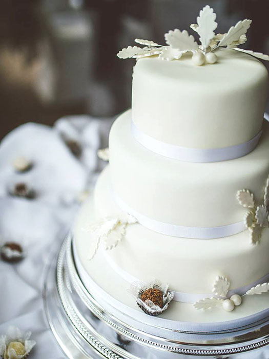 Ivory Wedding Cake with Berry Decorations