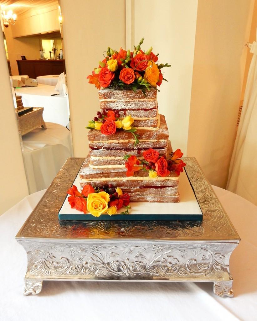 Victoria Sponge Wedding Cake with Orange and Yellow Flowers