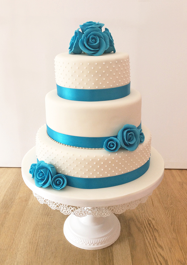 Wedding Cake With Turquoise Ribbon And Roses
