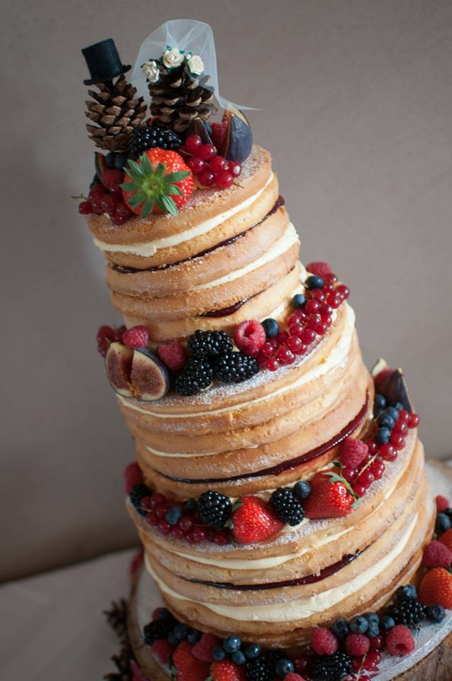 Naked Wedding Cake with Berries and Pine Cones