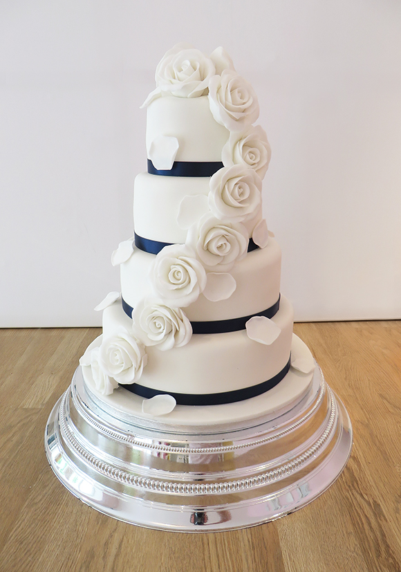 Navy Blue Wedding Cake With Cupcakes