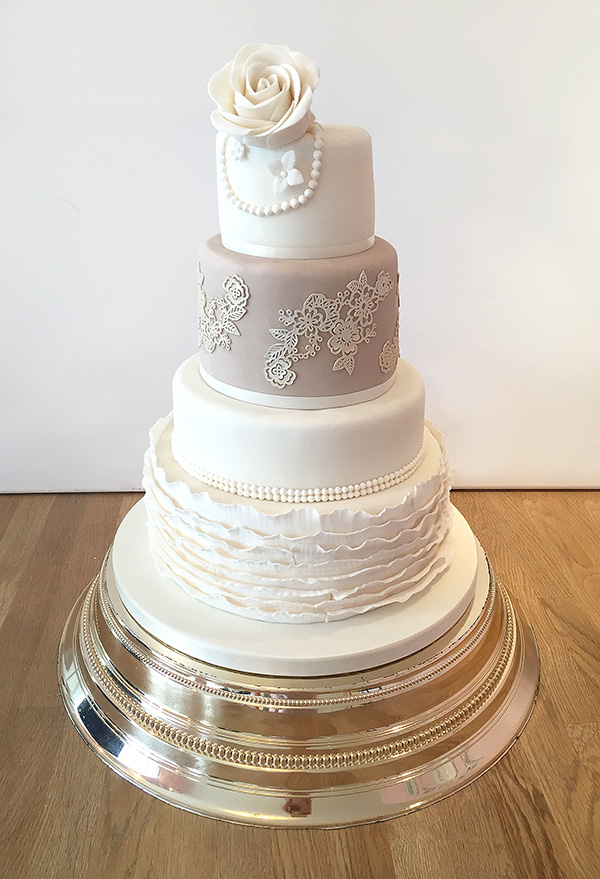 Ivory and Champagne Wedding Cake with Ruffles Lace and Pearls