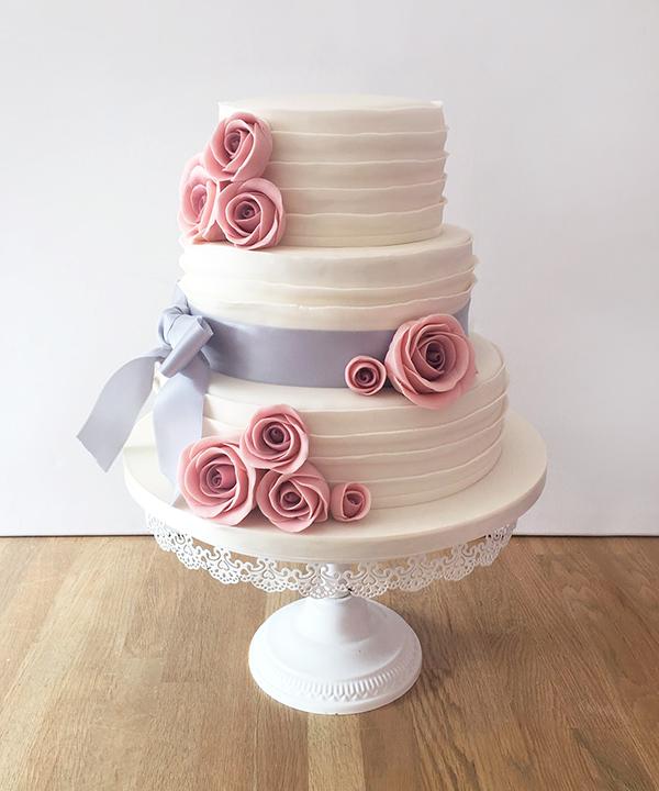 Ruffle Wedding Cake with Mauve Ribbon & Pink Roses