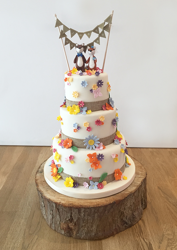 Cute Flowery Wedding Cake with Animal Cake Topper